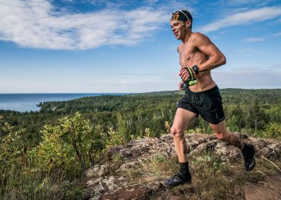 2018 Superior 100 Mile Winner Neal Collick Above Lake Superior at Split Rock - Photo Credit Ian Corless