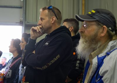 Listening Intently at the 100 Mile Pre-Race Meeting - Photo Credit Jamison Swift