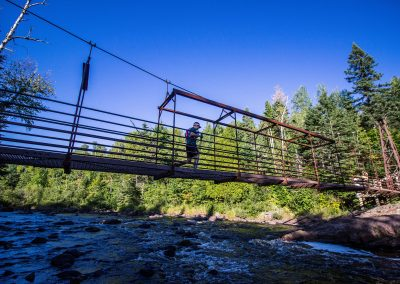 Suspension Bridge Above High Falls Baptisim River Tettegouche State Park - Photo Credit Fresh Tracks Media